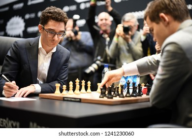 London, UK. 26 November, 2018. Magnus Carlsen competes against Fabiano Caruana in the World Chess Championship.
