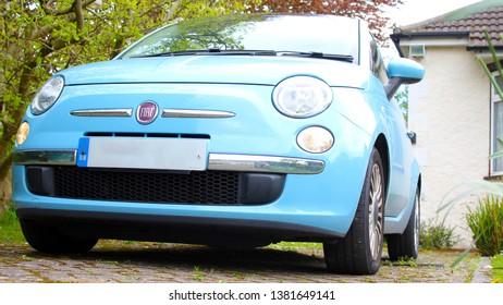 London UK 26th April 2019 Fiat 500 blue car parked on driveway