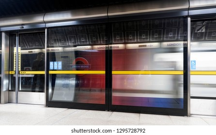 London, UK. 26th January 2019. A Jubilee Line London Underground train is speeding out of the station. This is the only line on the underground network to have safety doors on the platforms