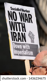 London, UK. 26th June 2019. Anti-war protester with placard at the DON'T ATTACK IRAN protest in Whitehall, London, to put pressure on the UK government to publicly oppose any allied military action.