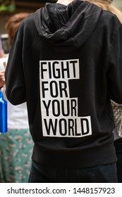 London, UK. 26th June 2019.  Protester wearing campaign hoodie at The Time Is Now demonstration. The mass rally around Parliament, in central London, UK, for action on climate change and environment.