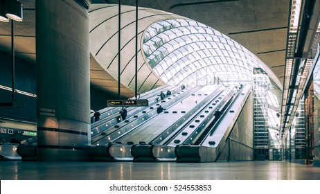 LONDON, UK - 27 APRIL 2015: The concourse of Canary Wharf tube station in London's Docklands business and finance district with business people making use of the escalators in and out of the station.