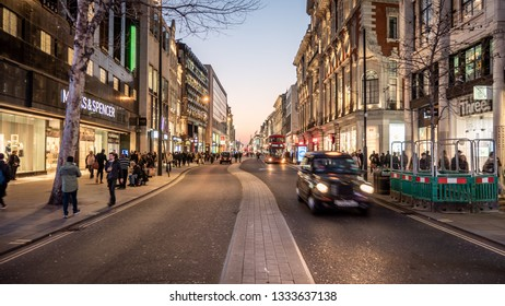 LONDON, UK - 27 FEBRUARY 2019: Late night shoppers and traffic on Oxford Street, central London, the retail and shopping district of the UK capital city.