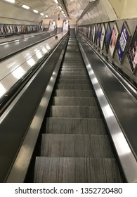 LONDON, UK - 27 MARCH 2019: escalators descending into London Underground.