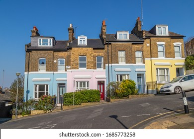 LONDON, UK - 27TH MARCH 2020: Colourful buildings along Point Hill in Greenwich. The exteriors can be seen painted in different colors.