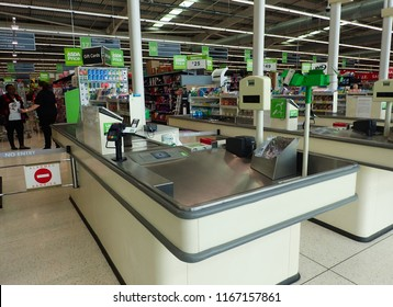 London, UK - 28 August 2018: Supermarket till registers and counters with recyclable bags.