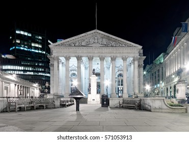 London, UK. 28th January 2017. The London Stock Exchange main entrance facade lit up at night on a cold January evening.