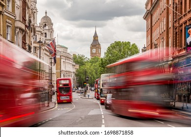 LONDON, UK - 28TH JUNE 2016: A view along Whitehall Street in London during the day towards Big Ben and Elizabeth Tower. London Buses can be seen.
