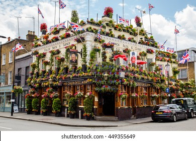 LONDON, UK - 28TH JUNE 2016: A view of the outside of the Churchill Arms in London. Large amounts of flowers and UK decorations can be seen on the exterior.
