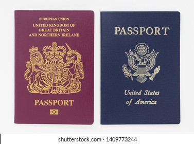 London, UK - 28th May 2019 - British and US passports, isolated on a white background
