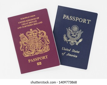 London, UK - 28th May 2019 British and US passports, isolated on a white background