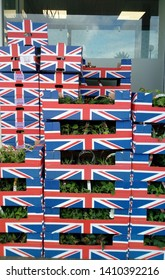 LONDON/ UK- 28th may 2019: Summer flowers on display, in Union Jack flag boxes, at London market.