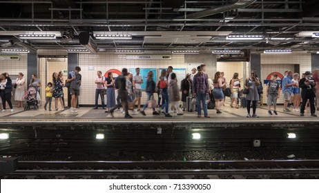 LONDON, UK - 29 AUGUST 2017: Tourists and commuters standing waiting on the west bound Circle and District Lines platform of the London Underground tube station at Victoria.