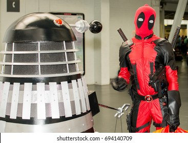 London, UK. 29th July 2017. EDITORIAL - Dalek from the Dr. Who tv series comes face to face with Deadpool at the London Film & Comic Con 2017 (Press pass/permission obtained from organisers)