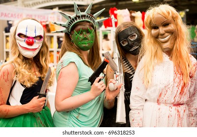 London, UK. 29th July 2017. EDITORIAL - Young girls dressed as characters from horror film The Purge at the London Film & Comic Con 2017 (Press pass/permission obtained from organisers)