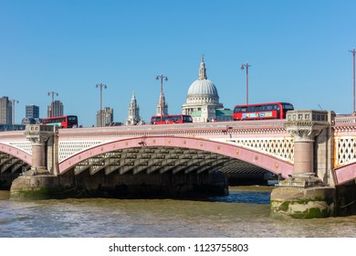 London. UK; 29th June 2018; Three Red London Buses Pass Over Blackfriars Bridge With the Dome of St Pauls Cathedral Visible Behind.