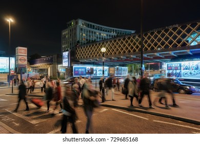 London, UK. 29th September 2017. Night capture of the streets around Waterloo station in central London. People are walking along the street by the many restaurants and bars.