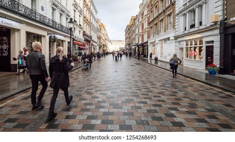 LONDON, UK - 3 DECEMBER 2018: Shoppers and tourists in the Covent Garden district of London. Gentrification has transformed this former market area into a fashionable retail and tourist location.