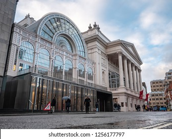 LONDON, UK - 3 DECEMBER 2018: A view of the facade to the Royal Opera House with it's adjacent glass and iron Floral Hall in the Covent Garden district of the West End of London.