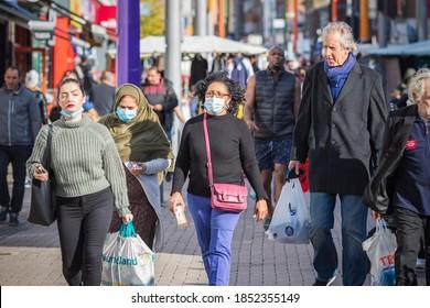 London, UK - 3 November, 2020 - People wearing face masks while shopping at Walthamstow market