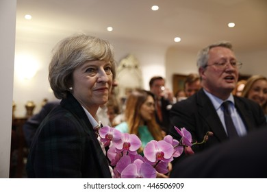 London, UK, 30th June, 2016. Theresa May receiving flowers after giving a talk on the Brexit and local matters to the Hampstead and Kilburn Conservative Association