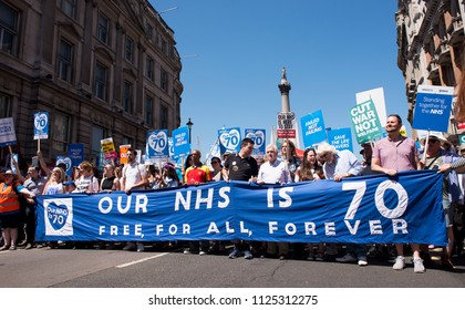 London, UK. 30th June 2018. EDITORIAL - Demonstrators at the NHS AT 70 rally, march through central London, demanding the NHS be publicly owned and that is free for all with proper funding & staffing.