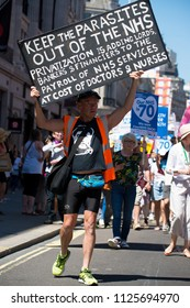 London, UK. 30th June 2018. EDITORIAL - Protester with poster at the NHS AT 70 rally, central London, UK,  demanding the NHS be publicly owned and that is free for all with proper funding & staffing.
