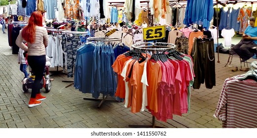 LONDON/ UK- 30th may 2019: Woman shopping for clothes, at Barking market in London's east end.