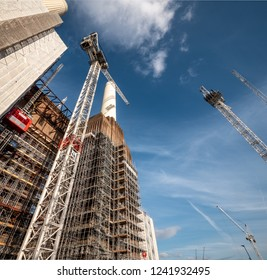 LONDON, UK - 31 OCTOBER 2018: A low angle view of the scaffolding, cranes and construction works carrying out the redevelopment of the iconic Battersea Power Station building in South West London.