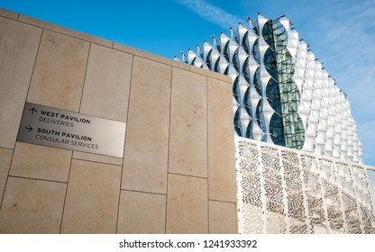 LONDON, UK - 31 OCTOBER 2018: A view of the exterior of the new US Embassy in the Nine Elms (Wandsworth) area of South West London with direction signage  on the heavily fortified walls.