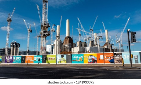 LONDON, UK - 31 OCTOBER 2018: Battersea Power Station redevelopment. Visible hoarding illustrates the effects gentrification will have on the area as residential and business changes take effect.