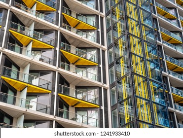 LONDON, UK - 31 OCTOBER 2018: Full frame abstract detail of the architecture of a contemporary apartment block in central London illustrating the open balconies and glass lift shaft.