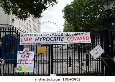 "London, UK - 31/08/19: ""Stop the Coup"" demonstration against the suspension of parliament and Brexit. ""Don't be fooled by Jacob Rees-Mogg! Liar Hyocrite Coward"" banner. ""Teddy bear tyrant"" sign."