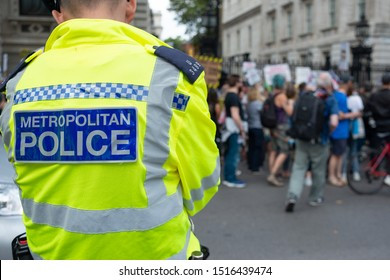 London, UK. 31st August 2019. Vigilant Metropolitan police officers, monitoring crowds of angry protesters at the Stop The Coup- Defend Democracy demonstration being held outside Downing Street.