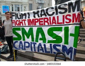 "London, UK. 3rd August 2019. Anti-Fascist campaigners with large banner at the ""Oppose Tommy Robinson"" counter demonstration, in protest of a march being held by far-right supporters of Mr Robinson."
