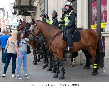 """London, UK. 3rd August 2019. Horse mounted police officers on standby at the """"Oppose Tommy Robinson"""" counter demonstration, in protest of a march being held by far-right supporters of Mr Robinson."""