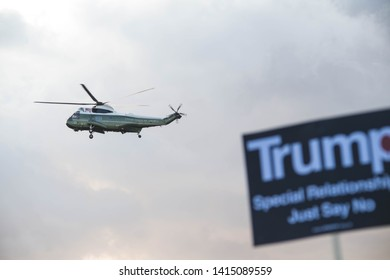 London, UK. 3rd June, 2019. People hold placards in protest as one of the President's Marine helicopters arrives for a State Banquet at Buckingham Palace  Michael Tubi / Alamy Live News