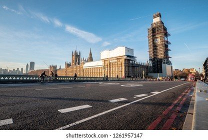 LONDON, UK - 4 DECEMBER 2018: An early morning view over Westminster Bridge towards the  Palace of Westminster with the Big Ben clock tower covered in scaffolding during renovation work.