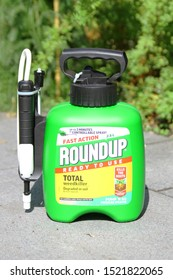 LONDON / UK - 4 OCTOBER 2019: RoundUp in garden. RoundUp is a brand of herbicide containing glyphosate by Monsanto Company