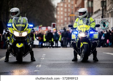 London, UK. 4th February 2017. EDITORIAL - Stop Trump's Muslim Ban rally - A Police escort as thousands march through London, in protest of President Trump's Muslim ban and his state visit to the UK.