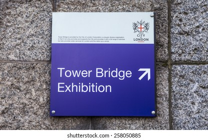 LONDON, UK - 4TH MARCH 2015: A sign for the Tower Bridge Exhibition tourist attraction in London on 4th March 2015.