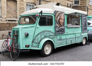 London, UK - 5th June 2017: A colourful and decorative vintage Citroen food van parked in a street market in the City of London.
