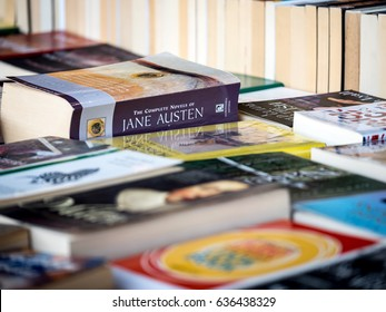 LONDON, UK - 6 APRIL 2017: Second hand book stall. Full frame detail of a book sellers stall with focus on the complete works of Jane Austen.