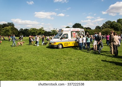 London, UK - 6 September 2015: People queuing in front of an ice-cream van in the Royal Park of Battersea, London, UK