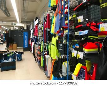 London, UK - 6 September 2018: Shop aisles with shelves full of sporting goods in a Decathlon shopping center mall.