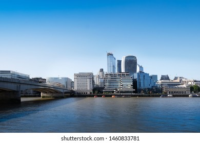 London, UK 6th July 2019: London skyline from south bank, river Thames in foreground on summer day, assorted business buildings from the old billingsgate market to  walkietalkie on Fenchurch Street