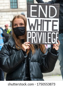 London, UK. 6th June 2020. Anti-racism campaigner with sign, at the Take The Knee demonstration in central London, in protest of the death of Black American George Floyd by US police in Minneapolis.