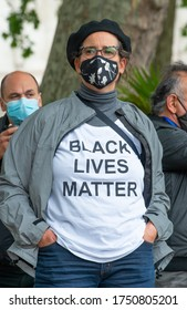 London, UK. 6th June 2020. Anti-racism campaigner with t-shirt, at the Black Lives Matter demonstration in London, in protest of the death of Black American George Floyd by US police in Minneapolis.