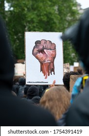 London, UK. 6th June 2020. Anti-racism clenched fist poster, at the Black Lives Matter demonstration in London, in protest of the death of Black American George Floyd by US police in Minneapolis.