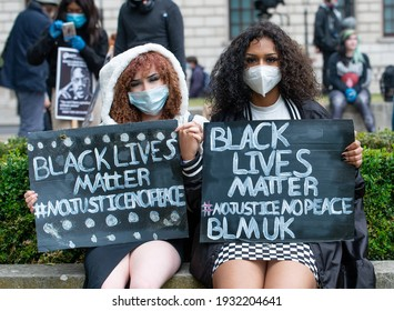 London, UK. 6th June 2020. Anti-racism campaigners holding signs, at the Black Lives Matter demonstration in London, in protest of the death of Black American George Floyd by US police in Minneapolis.